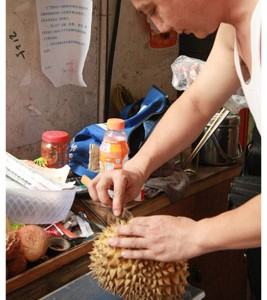 a fruit vendor in haikou, hainan island