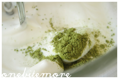 mixing the matcha powder into the meringue